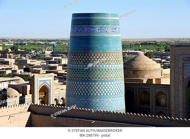 View onto the roofs of the old town and the unfinished minaret Kaltar Minor Khiva Uzbekistan