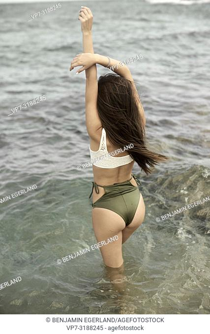Young woman at beach. Crete, Greece