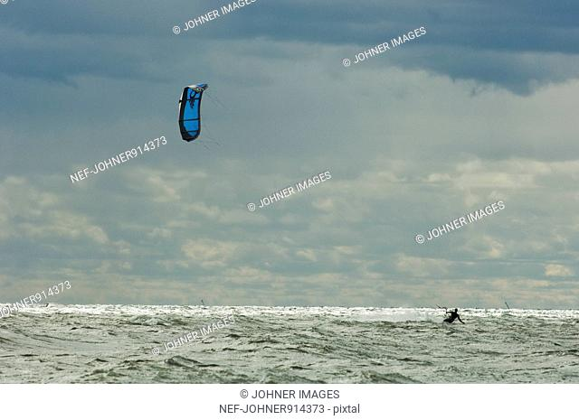 Scandinavia, Sweden, Man kiteboarding