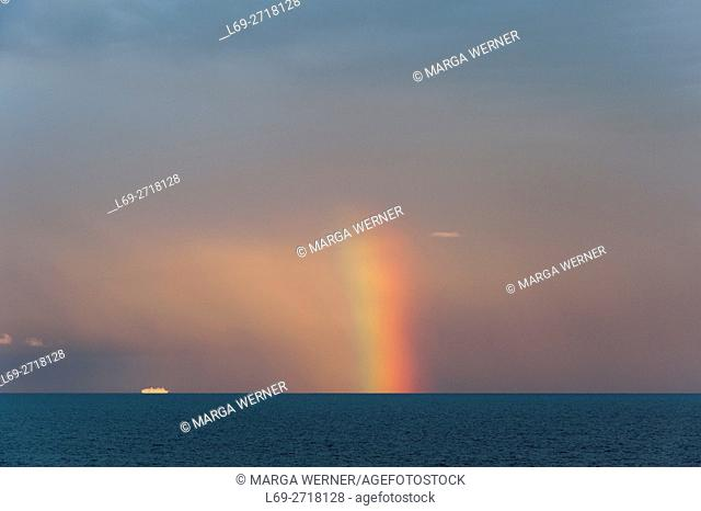 Rainbow over Baltic Sea and cruise ship, Europe