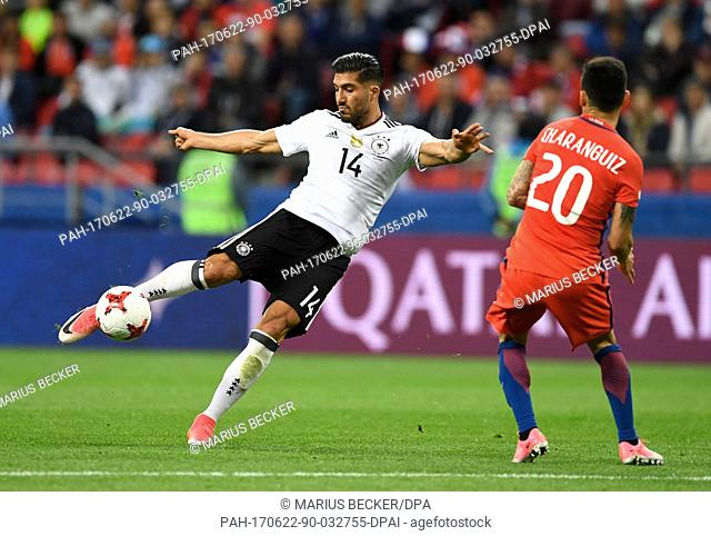 Germany's Emre Can (L) and Chile's Charles Aranguiz vie for the ball during the Group B preliminary stage soccer match between Chile and Germany at the...