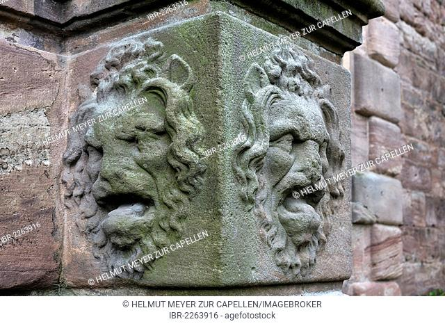 Two lion heads, reliefs, at the bottom of a column by the entrance to Christiansportal, built c. 1607, at Hohe Bastei, high bastion, in the courtyard