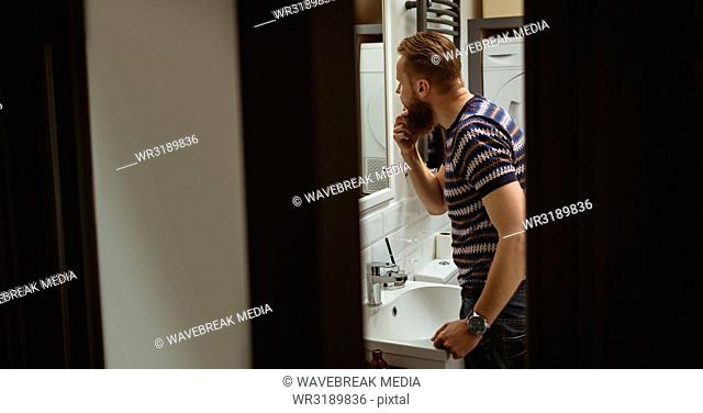 Man checking out himself in mirror