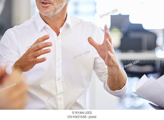 Businessman gesturing in meeting