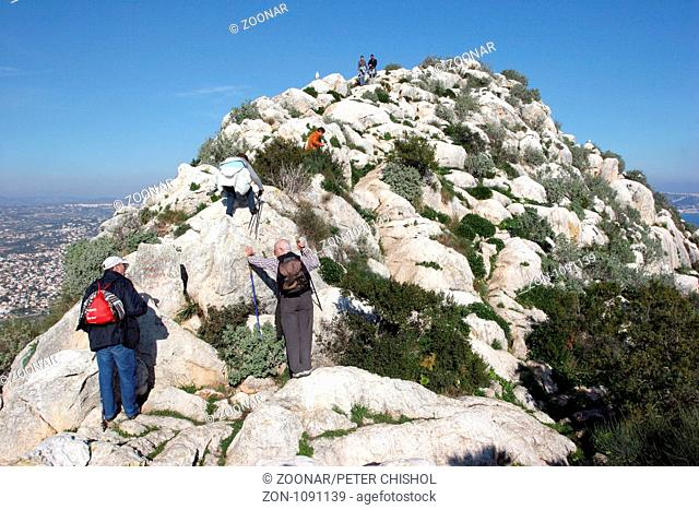 Hikers nearing the summit of The Penon de Ifach, Calpe