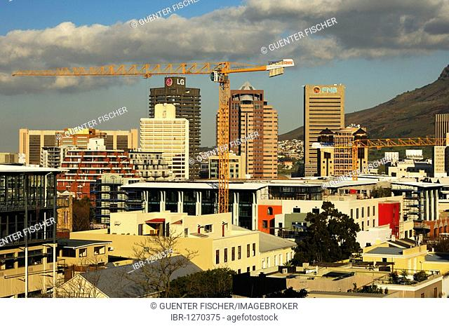 Cranes on construction sites in the city centre of Cape Town, mountain range of the Devil's Peak in the back, Cape Town, South Africa