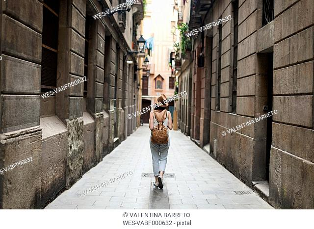 Young tourist discovering streets of Barcelona