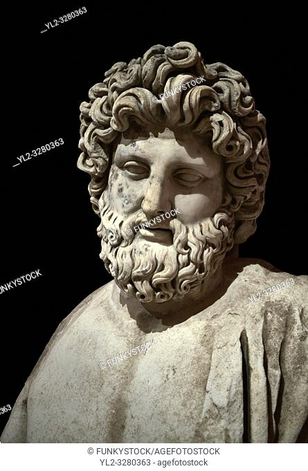 Roman statue of Asklepios. Marble. Perge. 2nd century AD. Inv no . Antalya Archaeology Museum; Turkey. Against a black background.