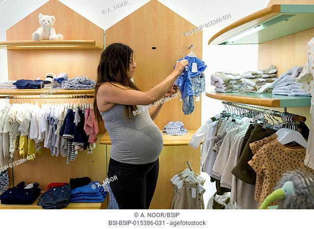 Reportage on Maureen during her second pregnancy. 9th month of pregnancy. Maureen shops in a baby shop