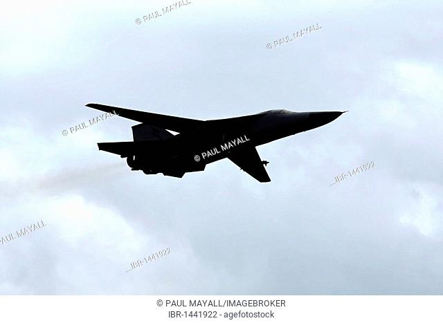 Military aircraft, General Dynamics F-111 swing wing fighter bomber in flight
