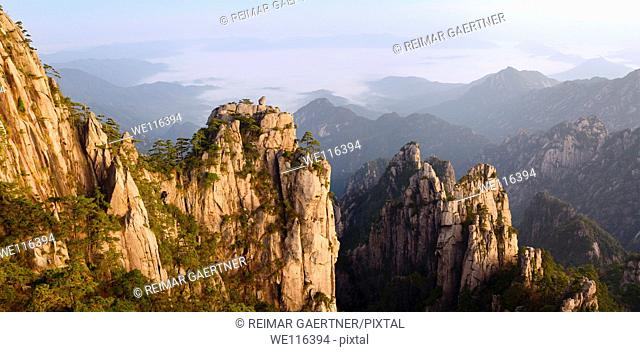 Panorama of Monkey watching the Sea Peak at dawn with fog in valley at Huangshan Mountains China