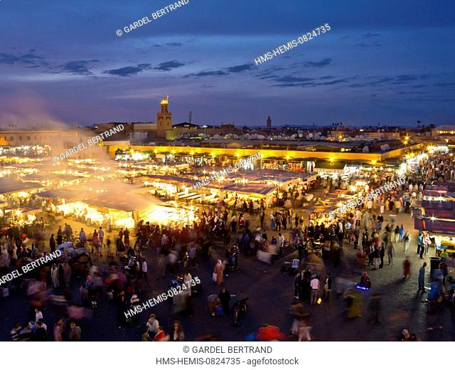 Morocco, Upper Atlas, Marrakech, imperial city, the medina listed World Heritage by UNESCO, Jemaa El Fna square, the stalls of restaurants settled from 4pm