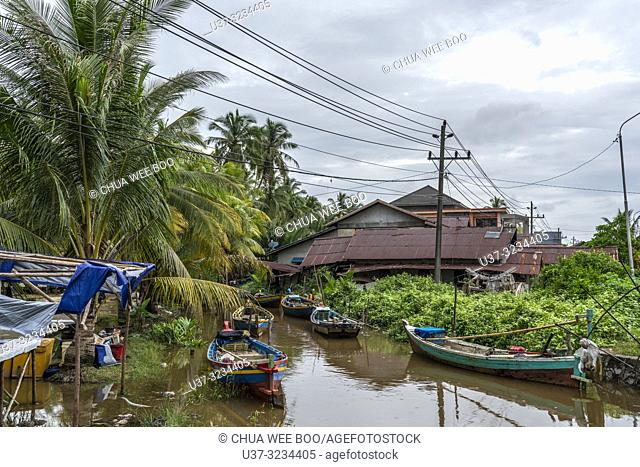 Small fishing boats at Sungai Bakau Kecil, West Kalimantan, Indonesia