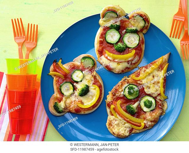 Pizza faces with vegetables