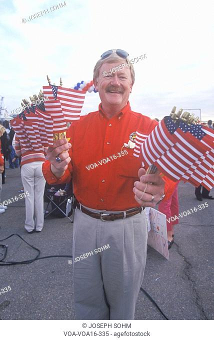 Man with miniature American flags