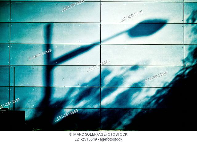 Shadow of a street lantern on a wall. Barcelona, Catalonia, Spain
