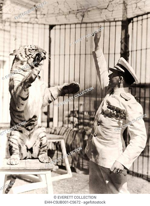 Capt. Roman Proske, an animal trainer born in Vienna in 1898. At age 13 he ran away from home to join the circus. He tamed and trained his big cats without...