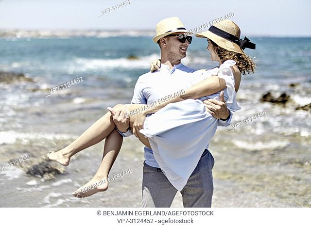 lovers, man carrying woman at beach, couple, vacations, summer, flirt