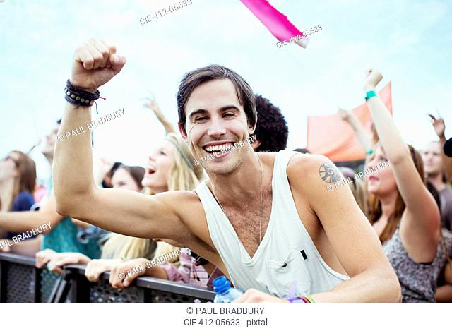 Enthusiastic man cheering at music festival