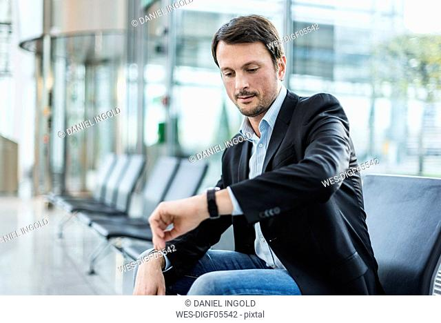 Businessman sitting at the airport, waiting