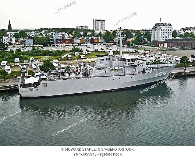 Royal Netherlands Navy submarine support and torpedo recovery vessel. Docked on the Warnow River at Warnemünde, Germany. This ship has also been identified as a...