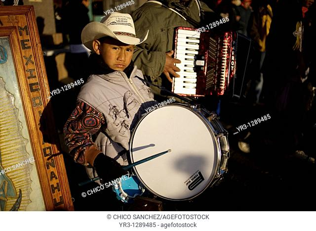 A boy plays a drum with a Mexican northern style band outside the Our Lady of Guadalupe Basilica in Mexico City, December 10