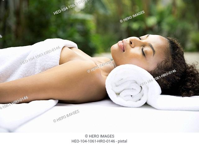 Relaxed woman on massage table