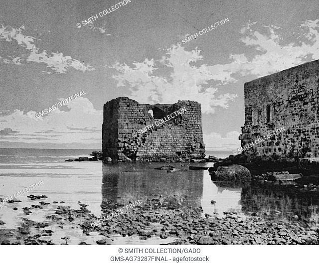 Black and white photograph of a shore, stone ruins in the shallow waters, captioned 'Tyr', Tyre, Lebanon, 1874. From the New York Public Library