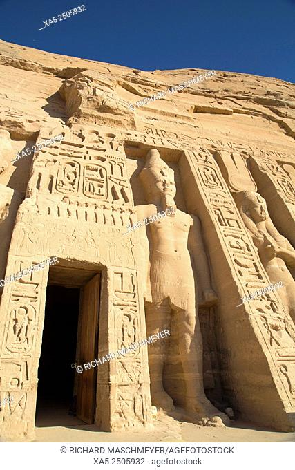 Temple Entrance (left), Rock-hewn Statues of Ramses II (left) and Queen Nefertatri (right), Hathor Temple of Queen Nefertari, Abu Simbel, Egypt