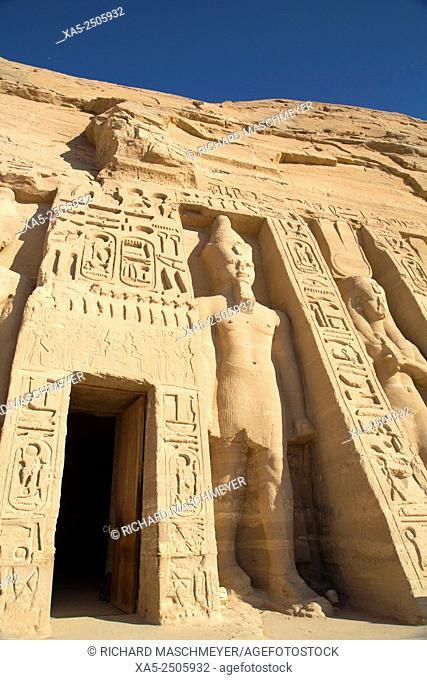 Temple Entrance (left), Rock-hewn Statues of Ramses II (left) and Queen Nefertatri (right), Hathor Temple of Queen Nefertari, Abu Simbel, Egypt