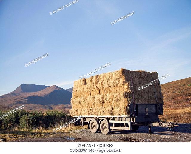 Trailer with haystack on roadside, North West Highlands, Scotland, UK