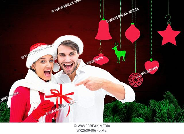 Excited couple holding christmas gift box