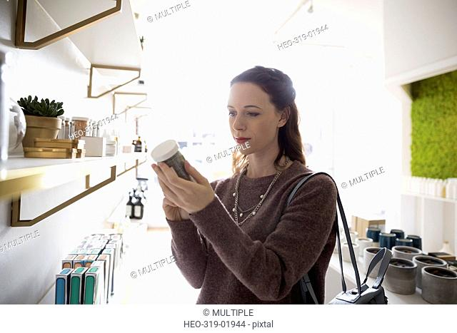Woman shopping browsing merchandise in home fragrances shop