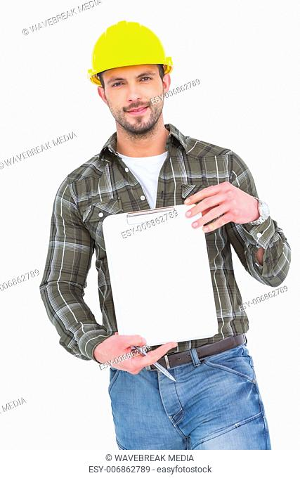 smiling manual worker holding clipboard
