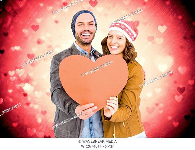 Romantic couple holding a heart
