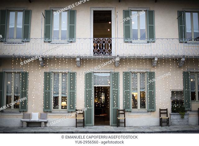 light rain hanging on a balcony of a villa, light decoration. Italy