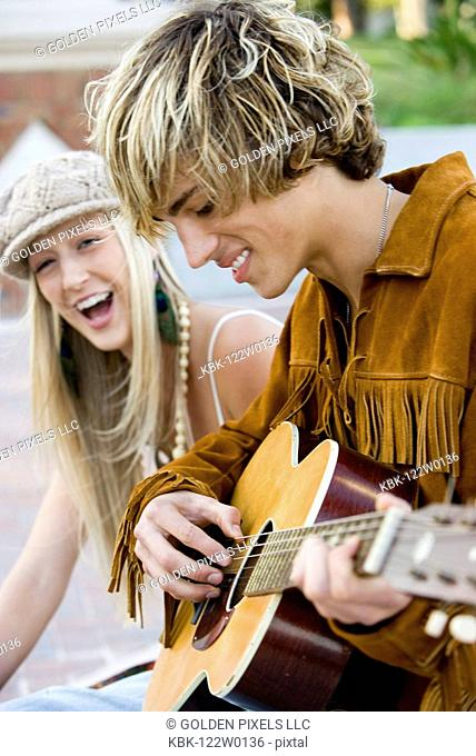 Young hippie couple with guitar