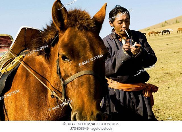 Mongolian nomads roam the vast Mongolian grasslands on their horses