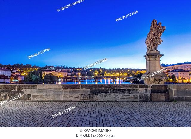 Statue and cobblestones on Charles Bridge at dawn, Prague, Czech Republic