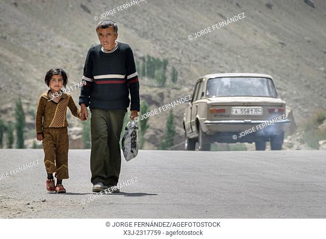 Man and daughter after hitchhiking a ride near Khorog, Pamir Highway, Tajikistan