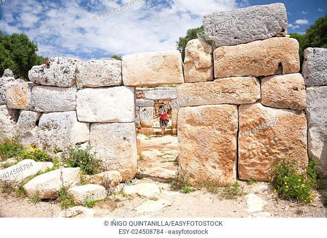 woman tourist visiting prehistoric monument in ancient town from Talayotic times in X century Before Christ, in Torralba den Gaumes or Galmes, in Alaior