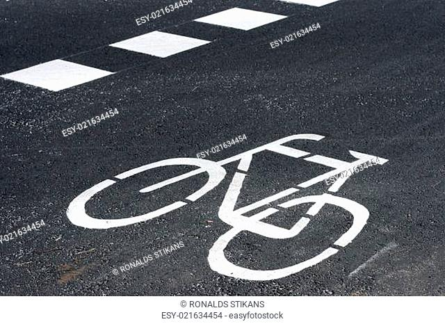 Bicycle road sign painted on the tarmac