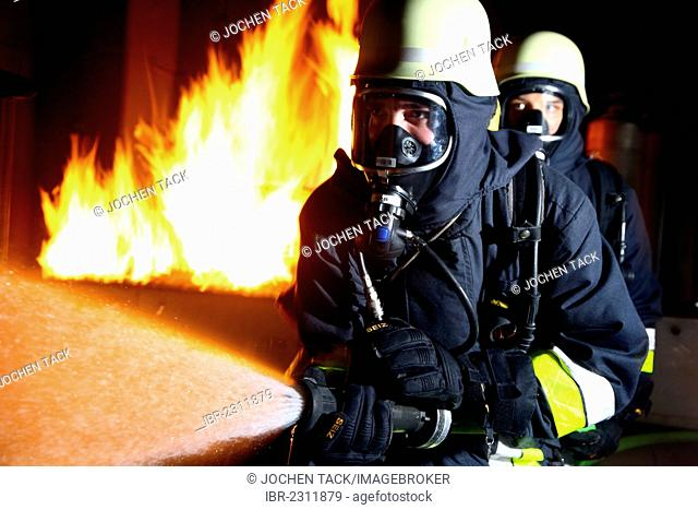 Firefighters training in a house fire, professional firefighters from the Berufsfeuerwehr Essen, Essen, North Rhine-Westphalia, Germany, Europe