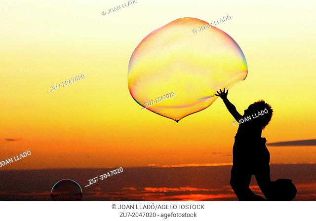 Soap bubbles in front of the sunset in Sant Antoni de Portmany, Ibiza