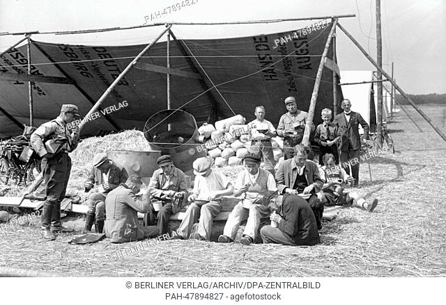 Nuremberg Rally 1933 in Nuremberg, Germany - Craftsmen have their lunch break during the setting up of the camp for SA (Sturmabteilung) units at the Langwasser...