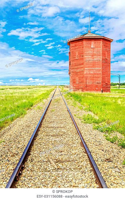 Old water tower or station along the railroad track on the prairies