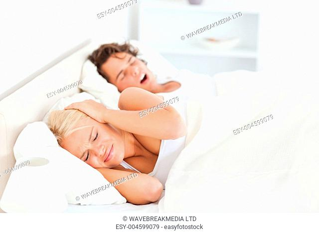 Annoyed woman awaken by her boyfriend's snoring