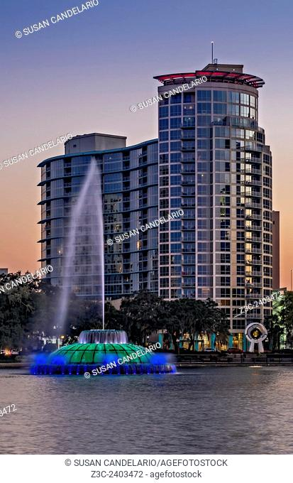 Lake Eola Water Fountain - The illuminated and multi color Linton E. Allen Memorial Water Fountain with the Waverly Water Building in the background