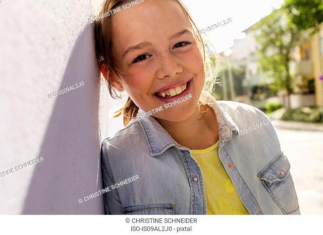 Teenage girl smiling, portrait