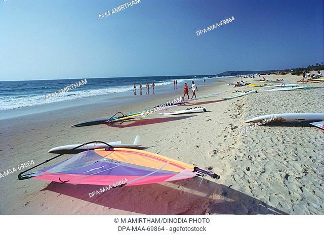 Wind surf riding boards kept at golden sand , Anjuna beach , Goa , India